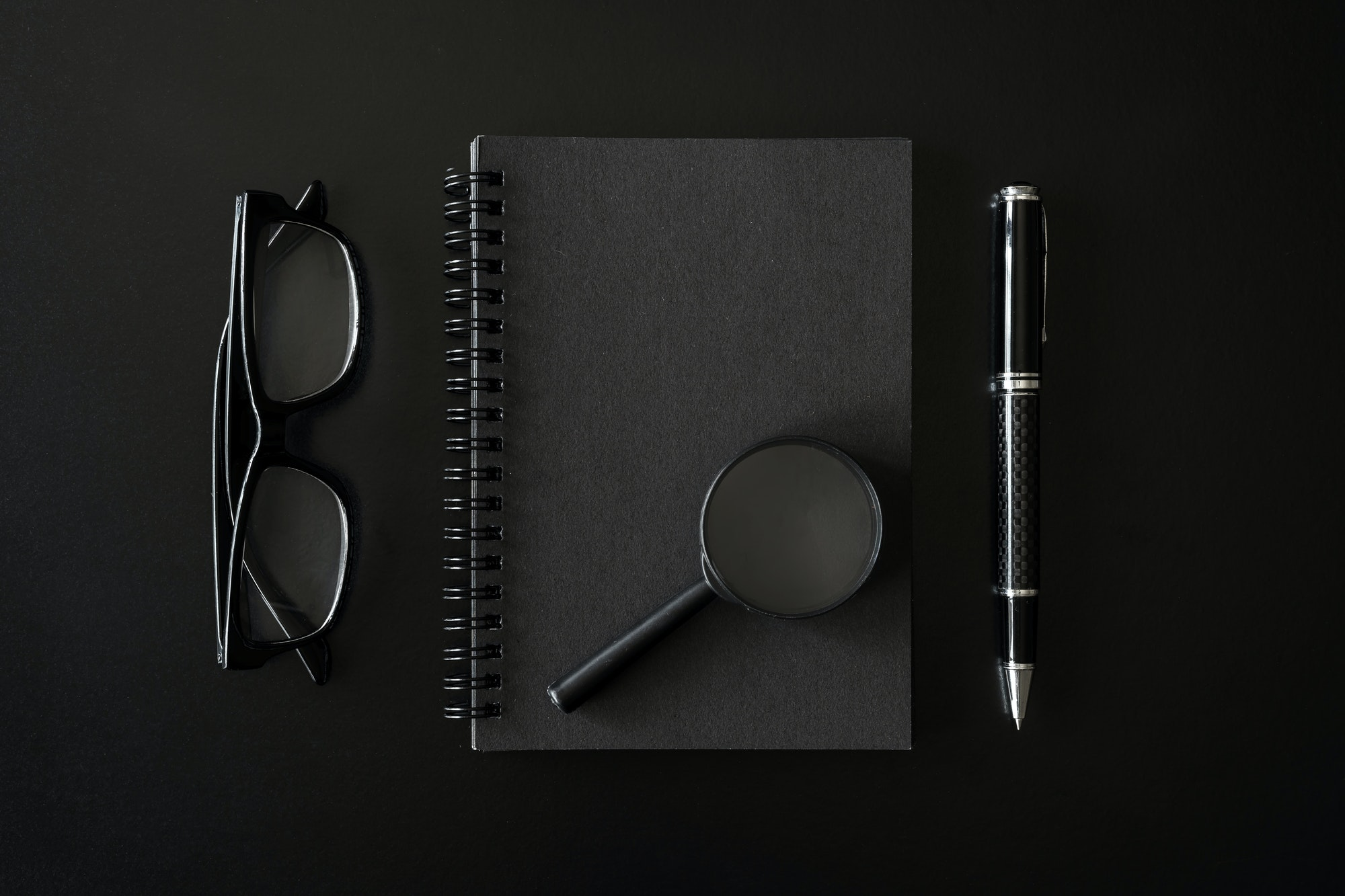 Black notebook with copyspace on black background